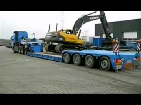 挖掘机上拖车怎么上,,要注意哪些
